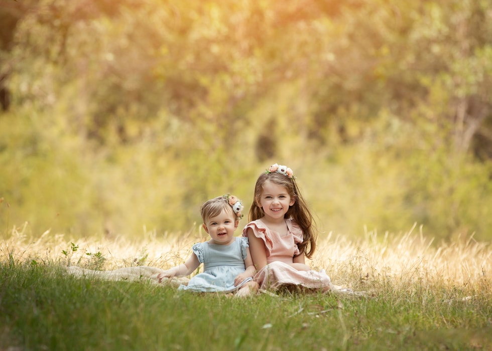 Two sisters pose for a kids photgraphy session by Howe Studios, Sydney