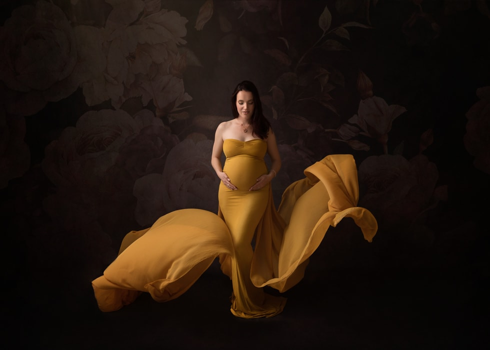 A mother-to-be poses for a meternity photography shoot at Howe Studios, Sydney